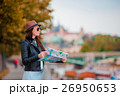 Happy young woman with a city map in city. Travel 26950653
