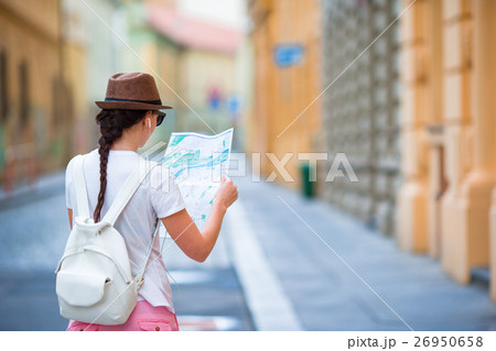 Happy young woman with a city map in city. Travel 26950658