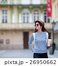 Happy young urban woman drinking coffee in Europe 26950662
