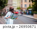 Young woman looking at touristic citymap. Happy 26950671