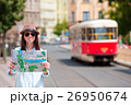 Young tourist girl with a city map searching 26950674