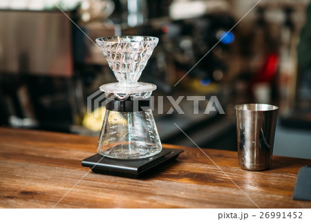 Coffee pot and metal glass on a bar counter.の写真素材 [26991452] - PIXTA
