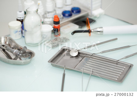 Dental tools on the table at dental office 27000132