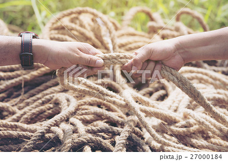 two people hands pulling the ropeの写真素材 [27000184] - PIXTA