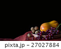 fruits on the table with a black background. 27027884
