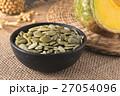 Green pumpkin seeds peeled in a black cup 27054096
