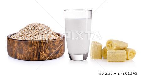 Oat flakes, banana and milk on white backgroundの写真素材 [27201349] - PIXTA