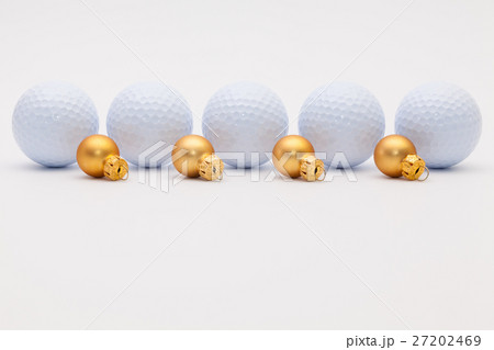 Golf balls and golden Christmas decorationの写真素材 [27202469] - PIXTA