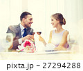 young couple with glasses of wine at restaurant 27294288