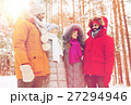 group of smiling men and women in winter forest 27294946