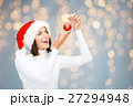 happy woman in santa hat with christmas ball 27294948