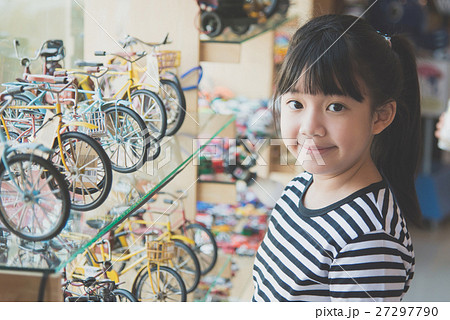 Portrait of beautiful Asian girl in toy's shop 27297790
