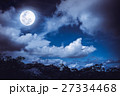 Silhouettes of tree and nighttime sky with clouds 27334468