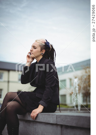 Businesswoman talking on mobile phone 27429066