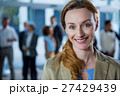 Smiling businesswoman in office 27429439