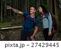 Hiker couple pointing at distance 27429445