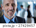 Smiling businessman standing in office 27429457