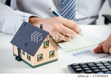 Businessman calculate the cost of building home for Calculate the cost of building a house