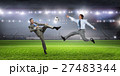 Businessman playing soccer 27483344