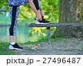 Runner girl tying laces shoes at the bench 27496487