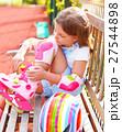 Little girl in roller skates 27544898