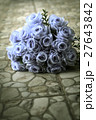 bouquet of blue rose lying on grey road 27643842