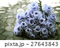bouquet of blue rose lying on grey road 27643843