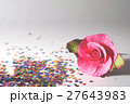 Artificial pink roses on a gray background  27643983