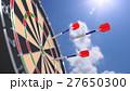 Arrow flying towards a bulls eye of a dart board 27650300