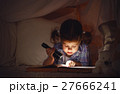 child girl with a book and a flashlight and teddy bear before go 27666241