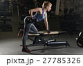 Young woman lifting the dumbbells 27785326