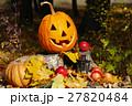 Halloween pumpkin on a stump in autumn forest. 27820484