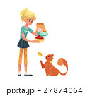 Teenage girl giving food to her fluffy red cat 27874064