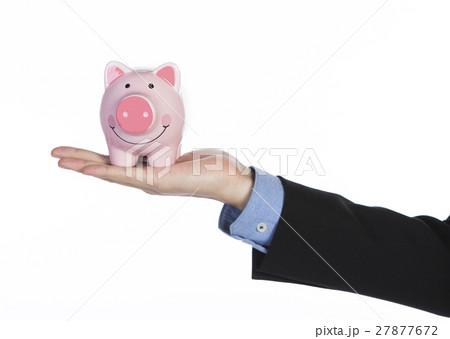 Man's hand with piggy hand 27877672