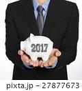 Man holding a piggy bank 27877673