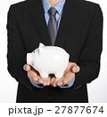 Man holding a piggy bank 27877674