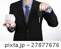 Man with a piggy bank and key 27877676