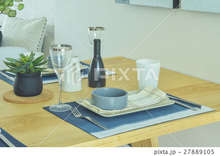 Dining set with pottery style on dining tableの写真素材 [27889105] - PIXTA