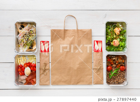 Healthy food take away in boxes, top view at wood 27897440