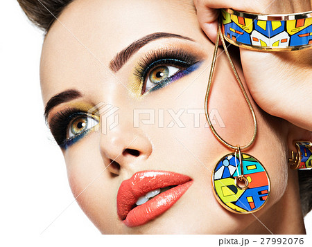 Beautiful woman with creative colored make-up. 27992076
