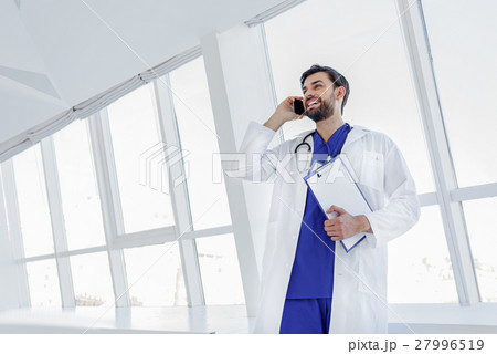 Happy male general practitioner telling good 27996519