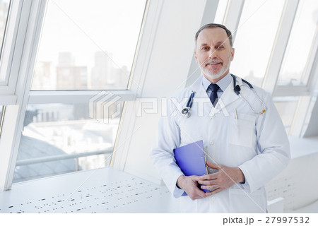 Mature doctor is happy about successful results of 27997532