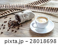 Cup of coffee with coffee beans 28018698