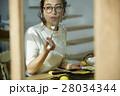 女性 朝食 食事の写真 28034344