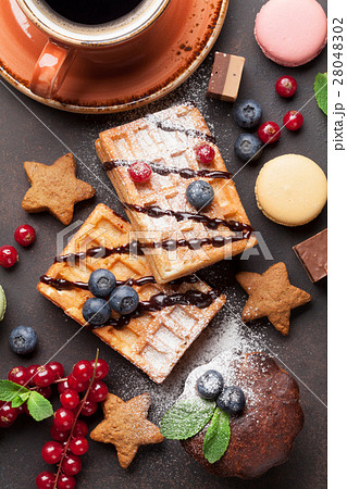 Coffee, sweets and waffles with berries 28048302