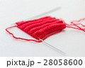 hand-knitted item with knitting needles 28058600
