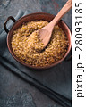 Grain bulgur in a copper bowl and wooden spoon  28093185