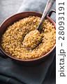 Bulgur in a copper bowl on the napkin 28093191