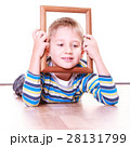 Boy lie on floor and play with frame. 28131799