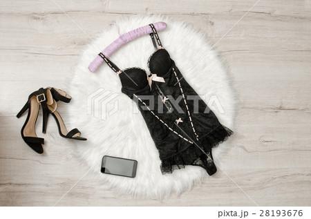 Black lace corset, shoes and smart phone on furの写真素材 [28193676] - PIXTA